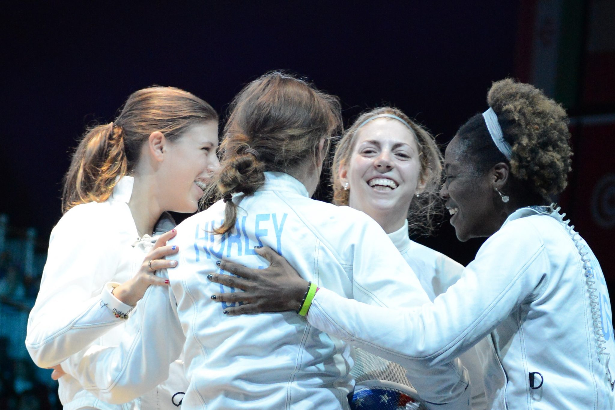 Susie Scanlan and the women's epee team after defeating Italy
